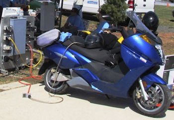 Electric motorcycle at charging station