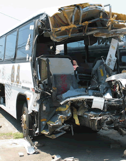 Bus mangled by bomb.