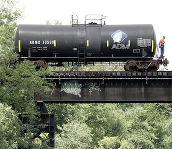 Freight rail car on bridge over Passic River.